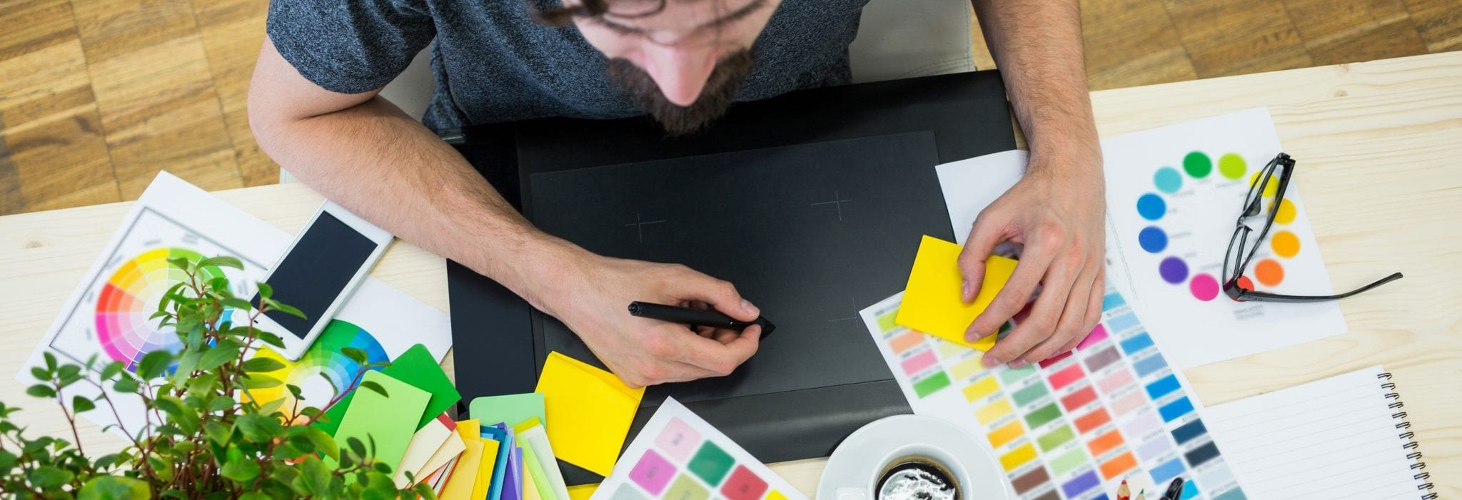 Male graphic designer using graphics tablet